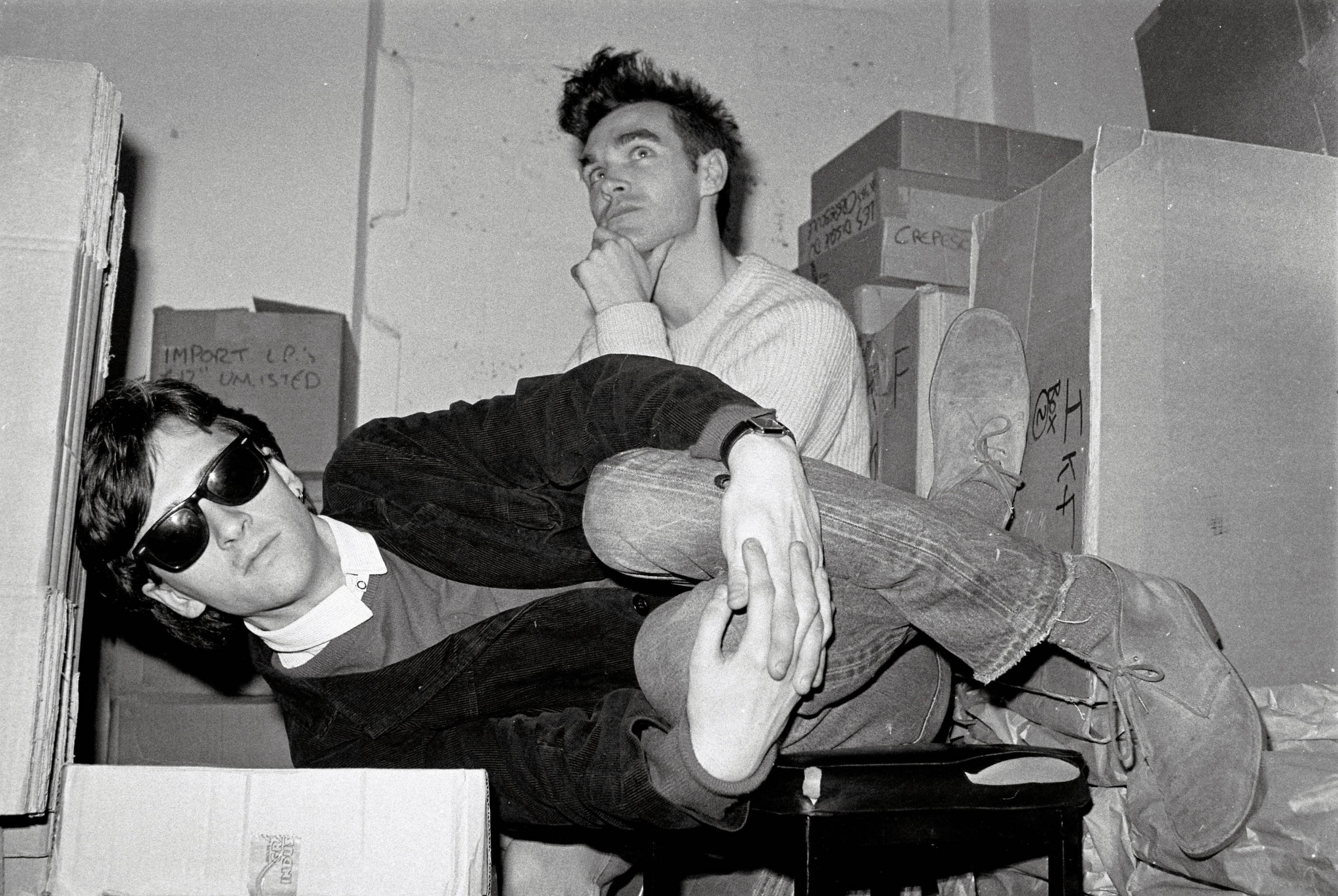 Marr (left) and Morrissey from The Smiths pose together in the store room of Rough Trade records in London, January 1983.