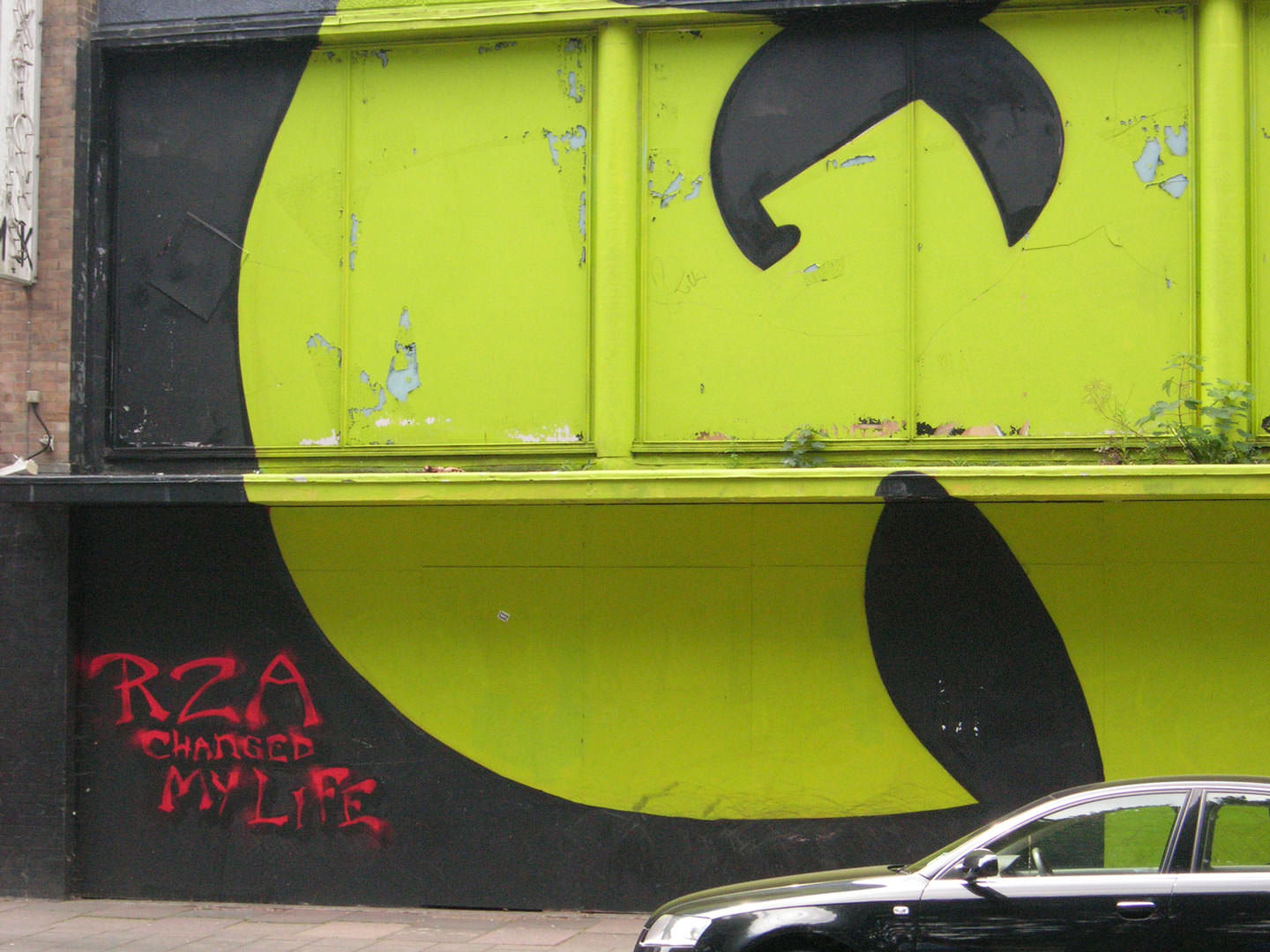 A photo of the Wu Tang Clan logo graffitied on a wall in Brighton. Next to is written: 'RZA changed my life'.